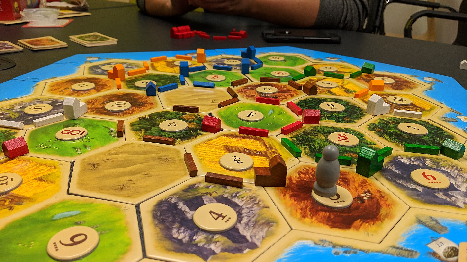 Image of the gameboard of Settlers of Catan in the middle of a game